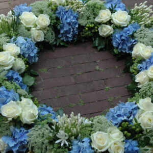 Wreaths and heartshaped funeral tributes